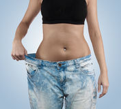 Woman with big jeans weight loss Stock Images
