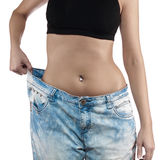 Woman with big jeans weight loss Stock Image