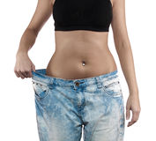 Woman with big jeans weight loss Royalty Free Stock Photography