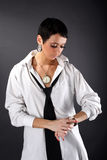 Woman in big man shirt looking in watch Royalty Free Stock Photo