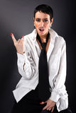 Woman in big man shirt and tie Stock Photo