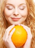 Woman with big orange Royalty Free Stock Photography