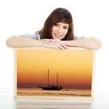 Woman with big picture Stock Image