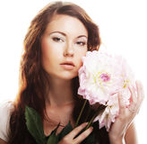 Woman with big pink flowers Royalty Free Stock Image