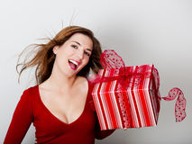 Woman with a big present Royalty Free Stock Photos
