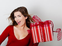 Woman with a big present Stock Images