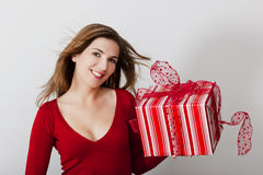 Woman with a big present Royalty Free Stock Image