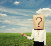 Woman with big question pointing Royalty Free Stock Image