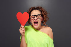 Woman with big red heart Royalty Free Stock Images