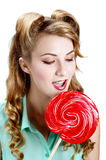 Woman with big red  lollipop Royalty Free Stock Photos