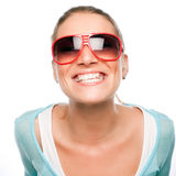 Grinning Woman in Sunglasses. Woman in big red sunglasses having fun smiling at the camera Stock Image