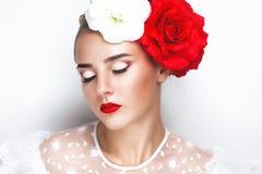 Woman with big roses Stock Photos