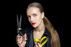 Woman with big sewing scissors stock image