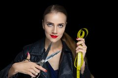 Woman with big sewing scissors royalty free stock photography