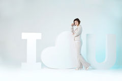 Woman and big sign I love you. Woman stands near a big sign I love you Royalty Free Stock Photo