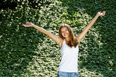 Woman with big smile and hands up Stock Photos