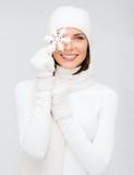 Woman with big snowflake Stock Image