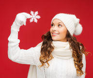 Woman with big snowflake Royalty Free Stock Photos