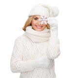 Woman with big snowflake Stock Images
