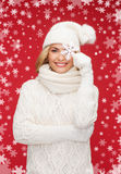Woman with big snowflake. Winter, people, happiness concept - woman in hat, muffler and gloves with big snowflake Stock Photos