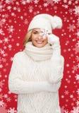 Woman with big snowflake Stock Photos