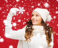 Woman with big snowflake Royalty Free Stock Photo