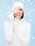 Woman with big snowflake Royalty Free Stock Image