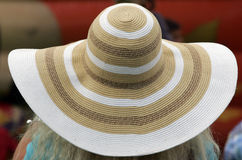 Woman Big Straw Hat. Woman in the back with a big straw hat Royalty Free Stock Photography