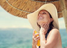 Woman in big straw hat enjoy with summer sun Stock Photos