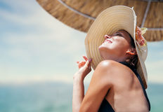 Woman in big straw hat enjoyed with summer sun Stock Photography