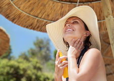 Woman in big straw hat enjoys summer sun Stock Photos