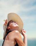 Woman in big straw hat in sun shine Stock Photography