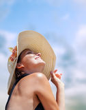 Woman in big straw hat in sun shine Royalty Free Stock Photos