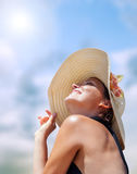 Woman in big straw hat in sun shine Royalty Free Stock Images