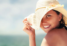Woman in big summer hat on the sea coast Stock Images