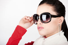 Woman with big sun glasses. Pretty woman with big sun glasses royalty free stock images