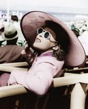 Woman in a big sun hat and sun glasses royalty free stock images
