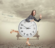 Woman with big white clock running Stock Image