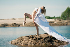 Woman with big white cloth Stock Images