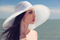 Woman in big white hat Royalty Free Stock Photo