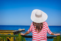 Woman in a big white hat looks at sea Royalty Free Stock Photography