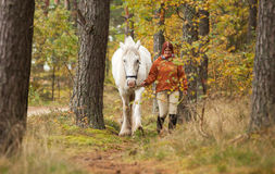 Woman with big white horse Stock Photography