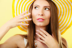 Woman in big yellow summer hat. Royalty Free Stock Image