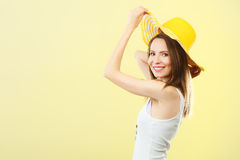 Woman in big yellow summer hat. Royalty Free Stock Photos