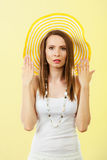 Woman in big yellow summer hat. Stock Photo