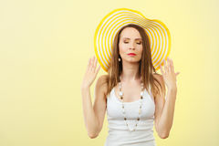 Woman in big yellow summer hat. Royalty Free Stock Images