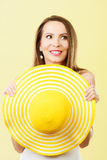 Woman in big yellow summer hat. Royalty Free Stock Photo
