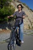Woman with bike. Beautiful woman on bike outdoors Royalty Free Stock Photos