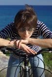 Woman with bike. Beautiful woman on bike outdoors Stock Photography