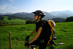 Woman and bike. Chiemsee-area in Alps. A woman with a bike Royalty Free Stock Image